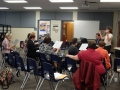 Jodi Rinehimer leading choral directors in a reading session
